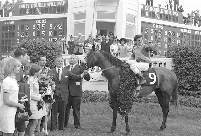 FILE - In this May 4, 1968, file photo, jockey Bob Ussery sits atop Dancer's Image in the winners circle at Churchill Downs in Louisville, Ky., after winning 94th Kentucky Derby. Holding the bridle is trainer Louis C. Cavalaris, Jr., center right, and owner Peter Fuller. At left is Fuller's wife and children. Sent off as the 7-2 second choice, Dancer's Image rallied from last to win by 1 1/2 lengths over Forward Pass. The result was declared official, but Dancers Image was later disqualified after traces of phenylbutazone, known as bute, were found in Dancer's Image's post-race urinalysis. Dancer's Image was placed 14th and last; Forward Pass was declared the winner.(AP Photo/File)