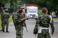 Soldiers patrol around a military battalion where a car bomb exploded, according to authorities, in Cucuta