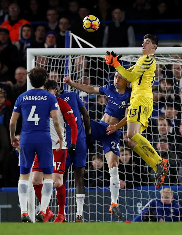 "Soccer Football - Premier League - Chelsea vs West Bromwich Albion - Stamford Bridge, London, Britain - February 12, 2018 Chelsea's Gary Cahill and Thibaut Courtois in action REUTERS/Eddie Keogh EDITORIAL USE ONLY. No use with unauthorized audio, video, data, fixture lists, club/league logos or ""live"" services. Online in-match use limited to 75 images, no video emulation. No use in betting, games or single club/league/player publications. Please contact your account representative for further details."