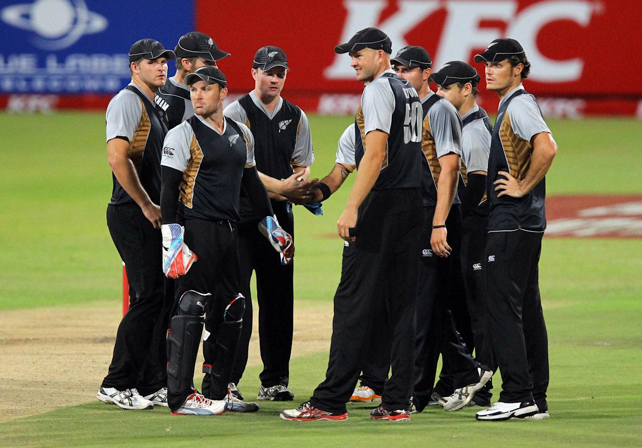 DURBAN, SOUTH AFRICA - DECEMBER 21:   New Zealand celebrate a wicket during the 1st T20 match between South Africa and New Zealand at Sahara Park Kingsmead on December 21, 2012 in Durban, South Africa.  (Photo by Anesh Debiky/Gallo Images/Getty Images)