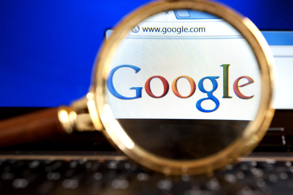 'Izmir, Turkey - June 11, 2012: Close up to Google website through a magnifying glass on the laptop. Google is the most popular search engine in the world.'