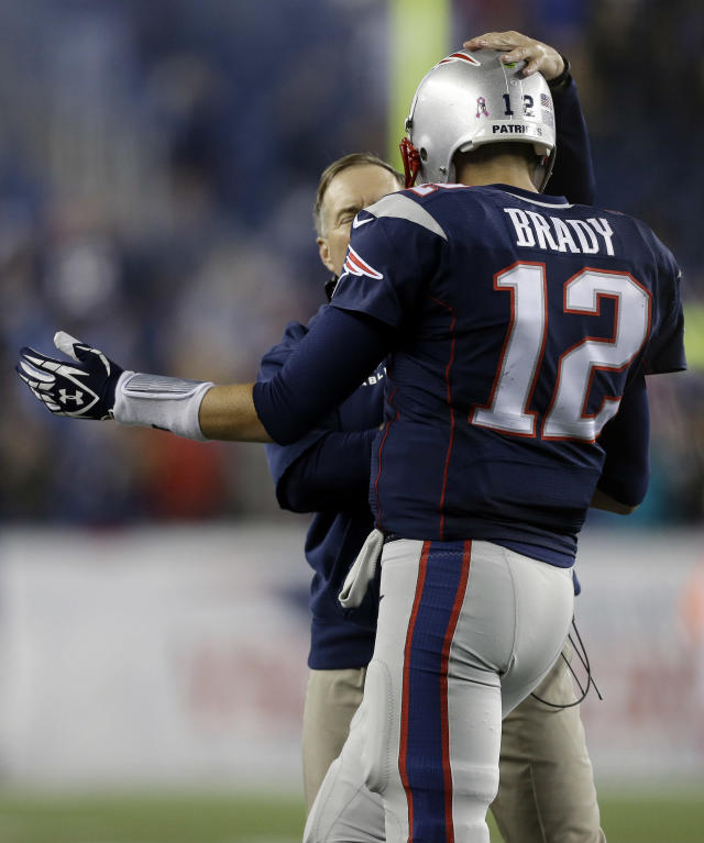New England Patriots head coach Bill Belichick, rear, congratulates quarterback Tom Brady on his winning touchdown pass against the New Orleans Saints in the fourth quarter of an NFL football game Sunday, Oct.13, 2013, in Foxborough, Mass. The Patriots won 30-27. (AP Photo/Steven Senne)