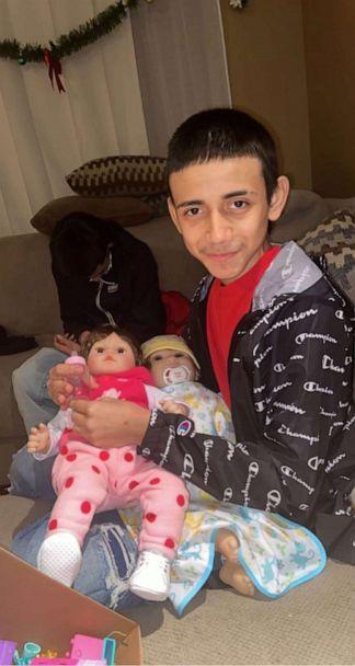 PHOTO: Adam Toledo is pictured with his cousin's 7-year-old daughter Kaylah's dolls, Jan. 1, 2021. Adam would play with them to make Kaylah laugh, his cousin told ABC News. (Courtesy of the Toledo Family)
