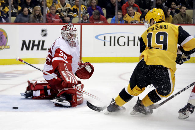 Pittsburgh Penguins' Derick Brassard (19) deflects the puck past Detroit Red Wings goaltender Jimmy Howard (35) for a goal during the second period of an NHL hockey game in Pittsburgh, Thursday, Dec. 27, 2018. (AP Photo/Gene J. Puskar)