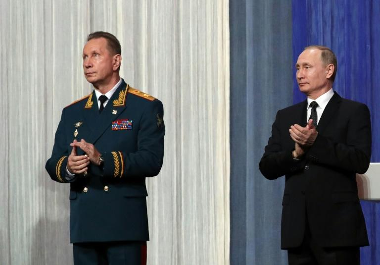 A close ally of Russian President Vladimir Putin (R), National Guard chief Viktor Zolotov (L) has created a video message blasting Kremlin critic and jailed opposition leader Alexei Navalny, who has accused him of corruption