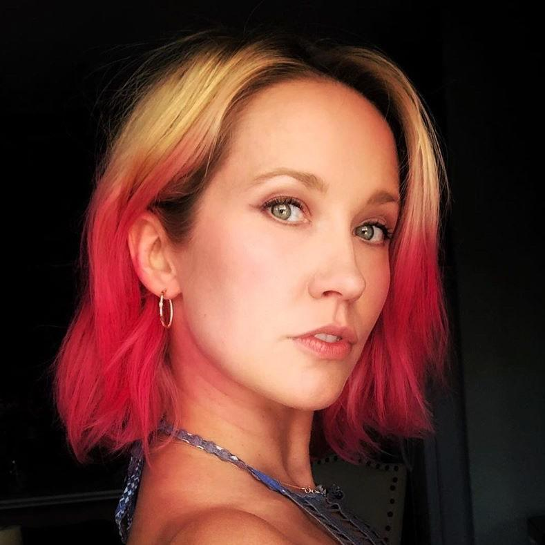 """""""Seeing how the state of the world is right now, we're looking for some escapism,"""" Elena says. And playing colorist, especially with a bold, rainbow hue like pink is a great way to do so. It was good enough for Anna Camp, who debuted her pink mids and ends to her Instagram followers back in early May. <br> <br> To preserve this hue at home, Elena suggests using a <a href=""""https://www.allure.com/gallery/best-hair-oils?mbid=synd_yahoo_rss"""" rel=""""nofollow noopener"""" target=""""_blank"""" data-ylk=""""slk:hair oil"""" class=""""link rapid-noclick-resp"""">hair oil</a>. """"For upkeep, hair oils like Jamaican black castor oil and almond oil would be great, especially when you wash your hair,"""" she tells <em>Allure</em>. """"Towel-dry gently and then use a generous amount."""""""