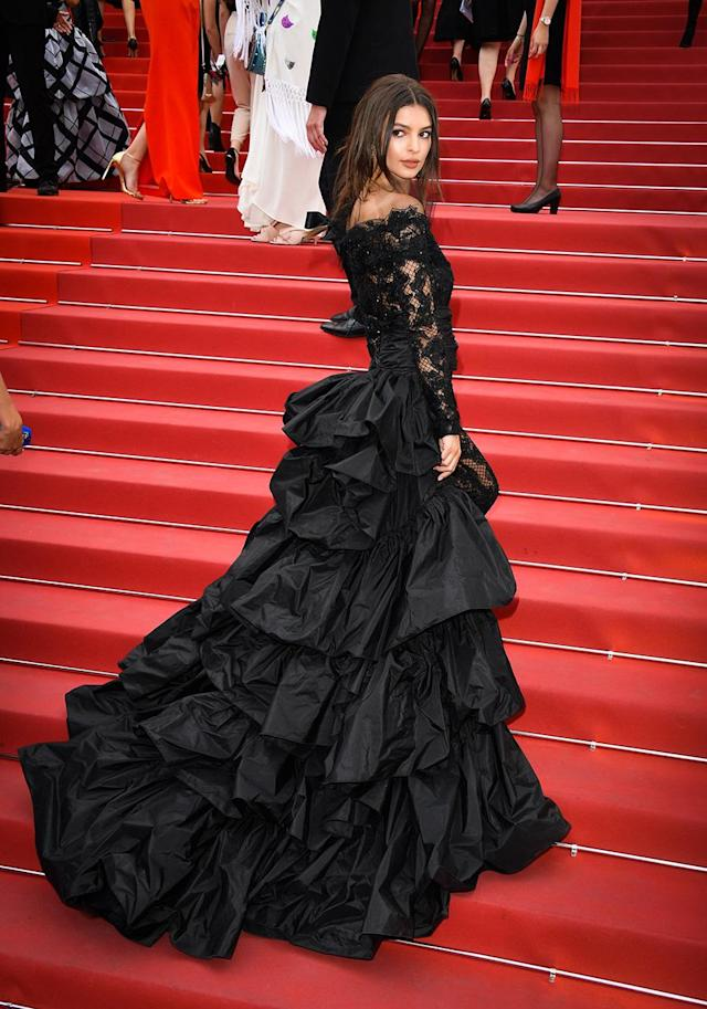<p>For Emily Ratajkowski's second Cannes red carpet appearance, she opted for a Madonna-inspired jumpsuit featuring lace leggings and a ruffle train designed by Peter Dundas. (Photo: George Pimentel/WireImage) </p>