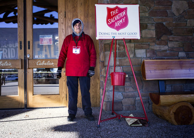 Salvation Army volunteers, like this man in Scarborough, Maine, are ubiquitous during the holiday season — although some, wary of the organization's past with the LGBTQ community, are hesitant about donating. (Photo: Derek Davis/Portland Portland Press Herald via Getty Images)