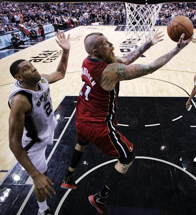 Miami Heat forward Chris Andersen (11) shoots as San Antonio Spurs forward Tim Duncan (21) during the second half in Game 1 of the NBA basketball finals on Thursday, June 5, 2014 in San Antonio. (AP Photo/Eric Gay, Pool)