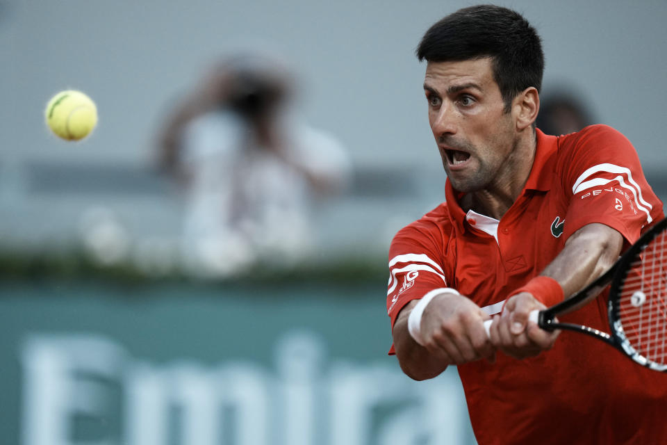 Serbia's Novak Djokovic returns the ball to Spain's Rafael Nadal during their semifinal match of the French Open tennis tournament at the Roland Garros stadium Friday, June 11, 2021 in Paris. (AP Photo/Thibault Camus)