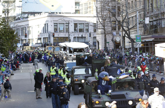 The Seattle Seahawks Super Bowl champions parade moves along the street on Wednesday, Feb. 5, 2014, in Seattle. The Seahawks beat the Denver Broncos 43-8 in NFL football's Super Bowl XLVIII on Sunday. (AP Photo/Ted S. Warren)