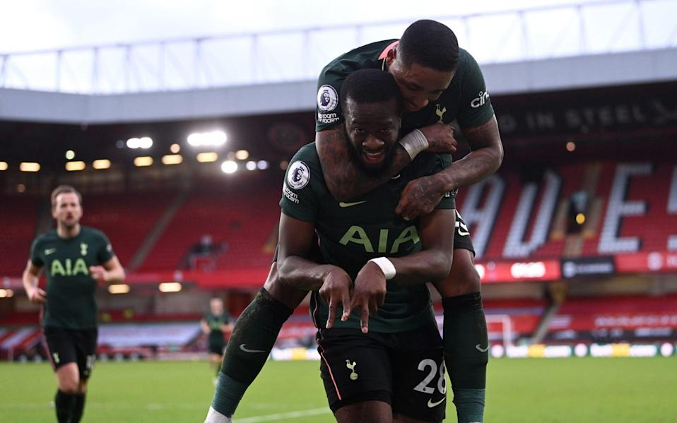 Steven Bergwijn jumped on Tanguy Ndombele's back following his spectacular strike - PA