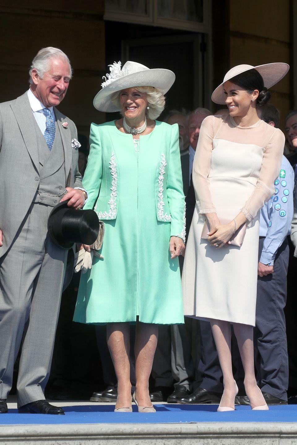 """<p>Camilla Parker Bowles wore a mint green ensemble and simple white hat to celebrate Prince Charles's various patronages for his 70th birthday in the <a href=""""https://www.townandcountrymag.com/society/tradition/g20871373/meghan-markle-prince-harry-first-post-royal-wedding-appearance-garden-party-photos/"""" rel=""""nofollow noopener"""" target=""""_blank"""" data-ylk=""""slk:Gardens of Buckingham Palace."""" class=""""link rapid-noclick-resp"""">Gardens of Buckingham Palace.</a></p>"""