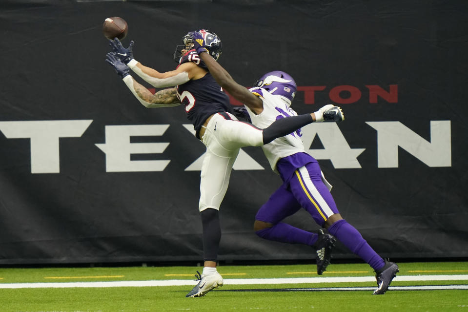 Houston Texans wide receiver Will Fuller (15) bobbles a catch in the end zone as Minnesota Vikings defensive back Holton Hill (24) defends the play during the second half of an NFL football game Sunday, Oct. 4, 2020, in Houston. (AP Photo/David J. Phillip)