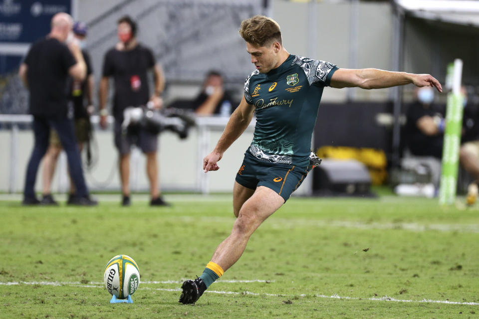 Australia's James O'Connor kicks a penalty goal during the Rugby Championship test match between the Pumas and the Wallabies in Townsville, Australia, Saturday, Sept. 25, 2021. (AP Photo/Tertius Pickard)