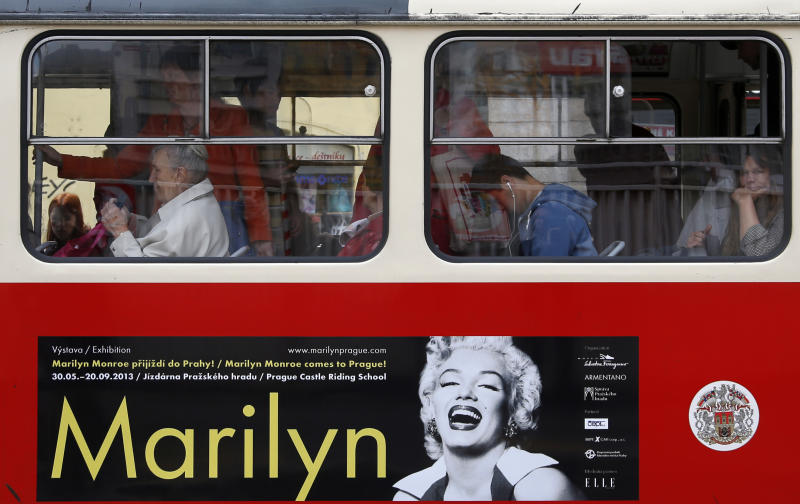 A poster advertising an upcoming Marilyn Monroe exhibition is seen on a tram in, Prague, Czech Republic, Wednesday, May 22, 2013. Alice Titzova of the PR agency 2media organizing the exhibition at the Prague Castle said some of the photographs of the star together with mannequins and display cases for the exhibition were stolen late Monday.  There was no word Wednesday whether the exhibition will be delayed or canceled. (AP Photo/Petr David Josek)