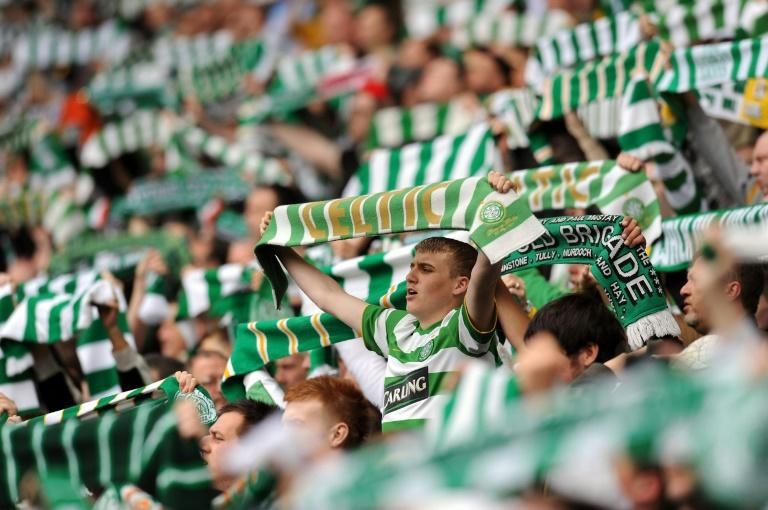 Celtic supporters sing before a Scottish Premier League football match in Glasgow, Scotland