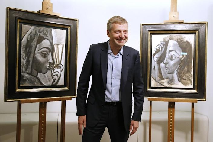 """Dmitry Rybolovlev paid 27 million euros ($30 million) in 2013 to buy Picasso's """"Woman Arranging her Hair"""" and """"Spanish Woman with a Fan"""" from art merchant Yves Bouvier (AFP Photo/Patrick Kovarik)"""