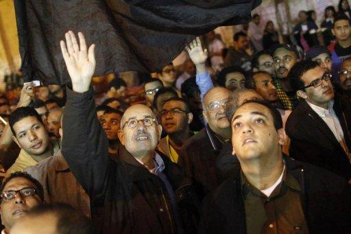 Mohammed ElBaradei (centre) leads a march in Cairo's Tahrir Square. Egypt's public prosecutor on Thursday ordered a probe into the top three leaders of the opposition on suspicion of trying to incite followers to overthrow President Mohamed Morsi, a legal source said