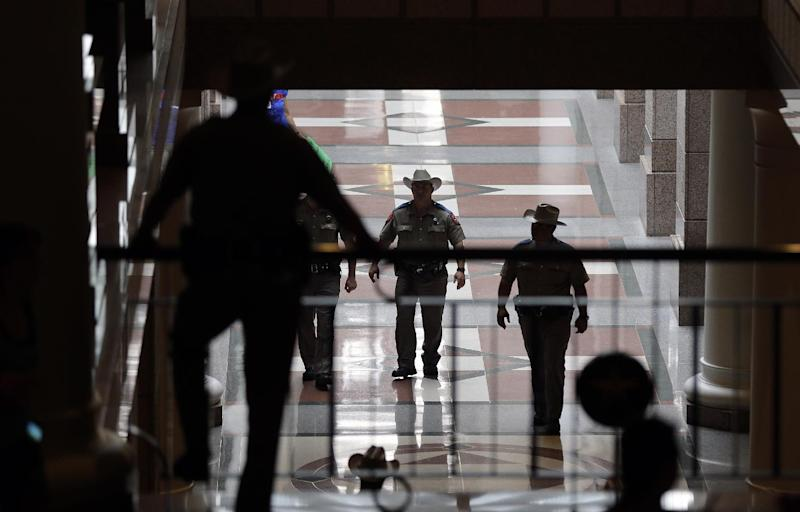 Texas state troopers patrol the halls of the Texas Capitol, Monday, July 8, 2013, in Austin, Texas. The fight over access to abortion in Texas resumed Monday with a Senate hearing and a nighttime anti-abortion rally at the Capitol. (AP Photo/Eric Gay)