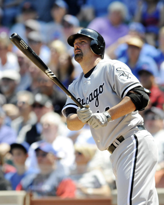 CHICAGO, IL - MAY 18: Paul Konerko #14 of the Chicago White Sox hits a two run homer in the first inning against the Chicago Cubs on May 18 2012 at Wrigley Field in Chicago, Illinois. (Photo by David Banks/Getty Images)