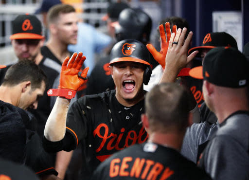 Baltimore Orioles shortstop Manny Machado (13) celebrates in the dugout after hitting a two-run home run during the 15th inning of a baseball game against the Atlanta Braves early Saturday, June 23, 2018, in Atlanta. Baltimore won 10-7 in 15 innings. (AP photo/John Bazemore)