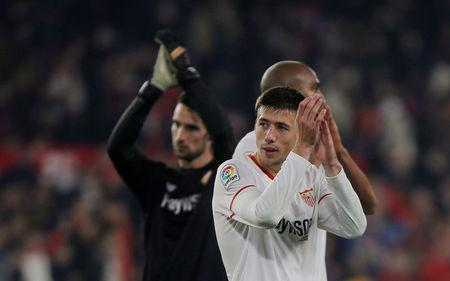 Soccer Football - Spanish King's Cup - Quarter Final Second Leg - Sevilla vs Atletico Madrid - Ramon Sanchez Pizjuan, Seville, Spain - January 23, 2018 Sevilla's Clement Lenglet applauds fans after the match REUTERS/Jon Nazca