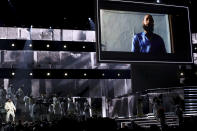 DJ Khaled, left, performs during a tribute in honor of the late Nipsey Hussle at the 62nd annual Grammy Awards on Sunday, Jan. 26, 2020, in Los Angeles. (Photo by Matt Sayles/Invision/AP)