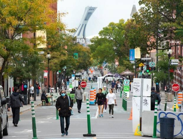 People walk along Mont-Royal Avenue last September. This year, the Mont-Royal Avenue merchants' association wants to close the street to traffic from the beginning of June to the middle of September.  (Ryan Remiorz/The Canadian Press - image credit)