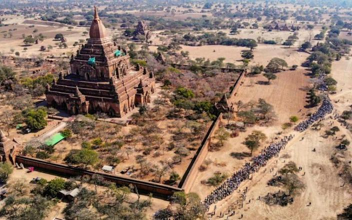 Protesters pack the road leading to a Unesco World Heritage site in Bagan - STR/AFP/Getty