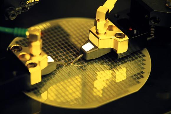 An uncut silicon wafer in the process of becoming several dozen semiconductor chips.