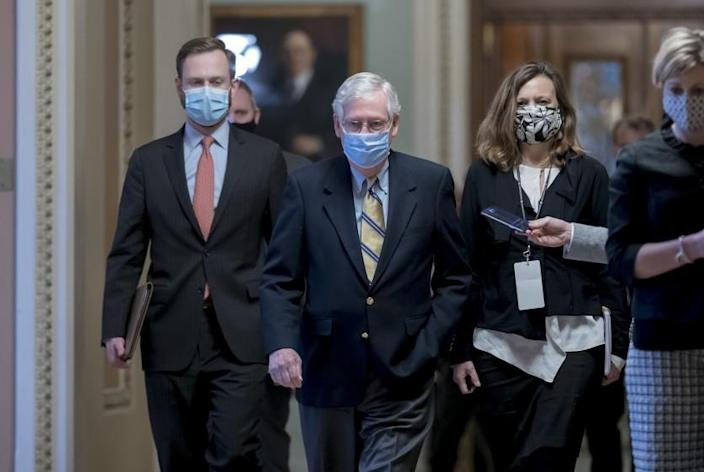 Senate Minority Leader Mitch McConnell, R-Ky., leaves the chamber after the Senate voted not guilty in the impeachment trial of former President Donald Trump on the charge of inciting the January 6 attack on the Congress by a mob of his supporters, at the Capitol in Washington, Saturday, Feb. 13, 2021. (AP Photo/J. Scott Applewhite)