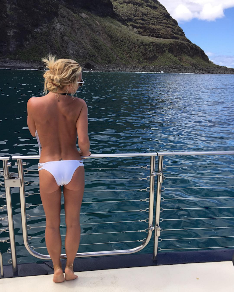 <p>Britney is really going for it on this boat in (half) a white bikini. </p>