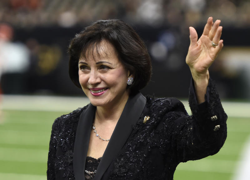 In this Sept. 16, 2018, photo, New Orleans Saints owner Gayle Benson waves before an NFL football game against the Cleveland Browns in New Orleans. New Orleans Saints and Pelicans owner Benson has paid off nearly $100,000 worth of layaway orders at a New Orleans Walmart. News outlets reported Tuesday, Dec. 4, 2018, that Benson has paid off more than 400 orders at the Tchoupitoulas Street store. NOLA.com/The Times-Picayune reports a Saints spokesman says Benson made the gift on her own.(AP Photo/Bill Feig)