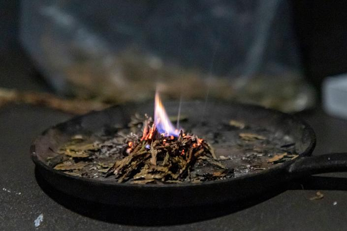 Sage is burned during a morning smudging and meditation practice at the Good Road Recovery Center in Bismarck, North Dakota. The smudging is intended to cleanse the mind, or soul and remove negative energy. June 22, 2021