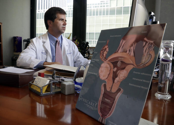 """Dr. Alan Copperman, Director of the Division of Reproductive Endocrinology at Reproductive Medicine Associates of New York, works in his office in New York, Thursday, Oct. 3, 2013. """"The modern family is created in a way that would be humbled by traditional fertility treatments,"""" said Copperman. """"We're seeing more and more couples come in and want to share the parenting experience,"""" and their medical forms more often say """"wife"""" rather than """"domestic partner."""" (AP Photo/Richard Drew)"""