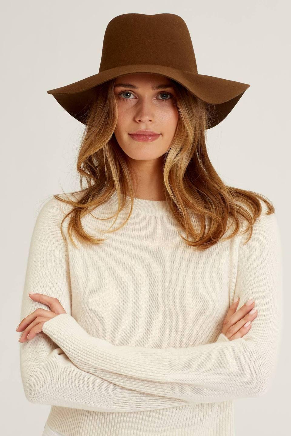 """<p>Naked Cashmere</p><p><strong>$125.00</strong></p><p><a href=""""https://go.redirectingat.com?id=74968X1596630&url=https%3A%2F%2Fwww.nakedcashmere.com%2Fcollections%2Fwomens-beanies-hats%2Fproducts%2Fluna-hat&sref=https%3A%2F%2Fwww.countryliving.com%2Fshopping%2Fg37003543%2Ffall-hats-women%2F"""" rel=""""nofollow noopener"""" target=""""_blank"""" data-ylk=""""slk:SHOP NOW"""" class=""""link rapid-noclick-resp"""">SHOP NOW</a></p><p>If you're into less structure than the classic fedora hat, a wide brim floppy one might be right up your alley! Available in Mocha (shown), Dark Caramel, and Black, this simple hat will be perfect for brunch with girls and fun days in the fall sun.</p>"""