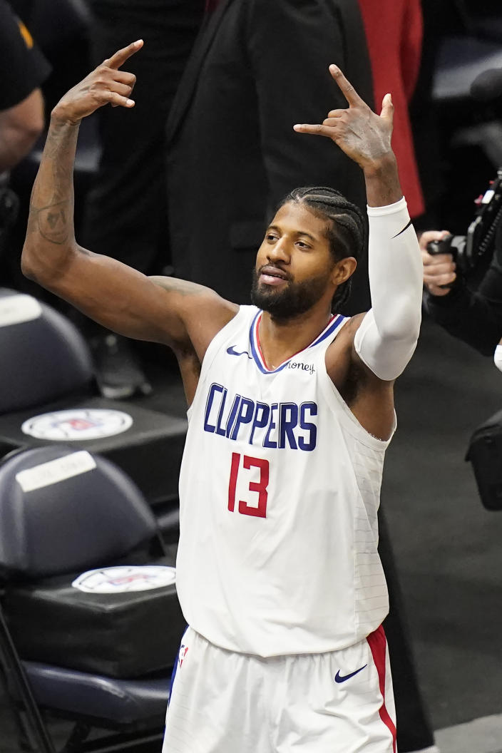 Los Angeles Clippers guard Paul George celebrates as he heads to the bench during the second half of Game 5 of the team's second-round NBA basketball playoff series against the Utah Jazz on Wednesday, June 16, 2021, in Salt Lake City. (AP Photo/Rick Bowmer)