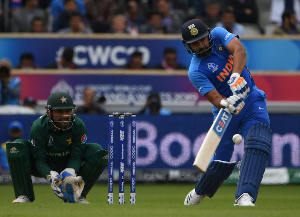 Sharma continues to attack the Pakistan bowlers (Photo by PAUL ELLIS/AFP/Getty Images)