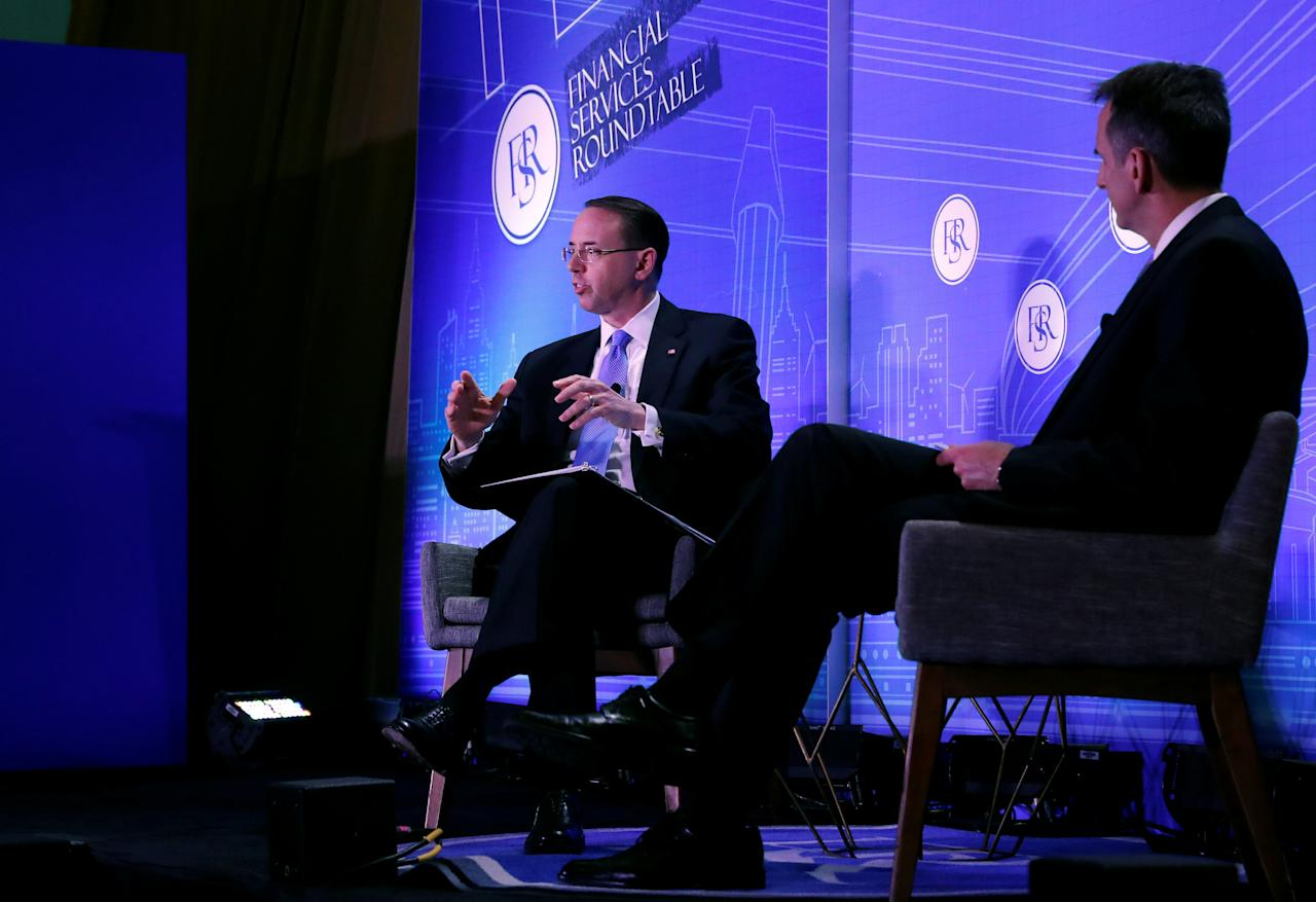 Deputy U.S. Attorney General Rod Rosenstein (L) is interviewed by Financial Services Roundtable President and CEO Tim Pawlenty during the Financial Services Roundtable spring conference at The Wharf Intercontinental Hotel in Washington, U.S., February 26, 2018. REUTERS/Leah Millis