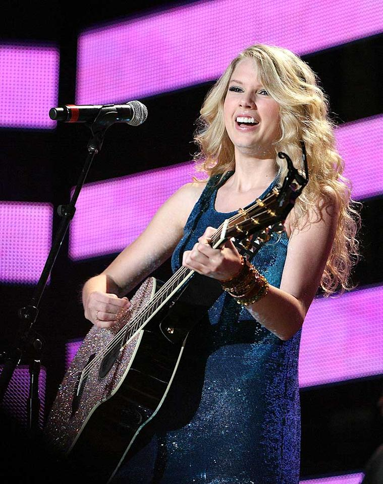 "Teen recording titan Taylor Swift entertains with her glittery guitar and bevy of hits including ""Picture to Burn"" and ""Should've Said No."" Tony R. Phipps/<a href=""http://www.wireimage.com"" target=""new"">WireImage.com</a> - June 5, 2008"