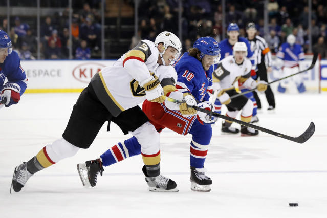 Vegas Golden Knights defenseman Brayden McNabb (3) and New York Rangers center Artemi Panarin (10) go after the puck during the second period of an NHL hockey game, Monday, Dec. 2, 2019, in New York. (AP Photo/Kathy Willens)