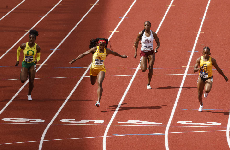 North Carolina A&T's Cambrea Sturgis, right, wins the women's 100 meters during the Division I Outdoor Track and Field Championships, Saturday, June 12, 2021, at Hayward Field in Eugene, Ore. (AP Photo/Thomas Boyd)