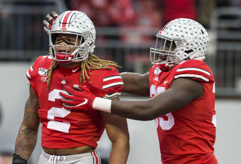 Ohio State defensive end Chase Young (2) is congratulated by Zach Harrison (33) after a sack against the Penn State Nittany Lions. (USA Today)