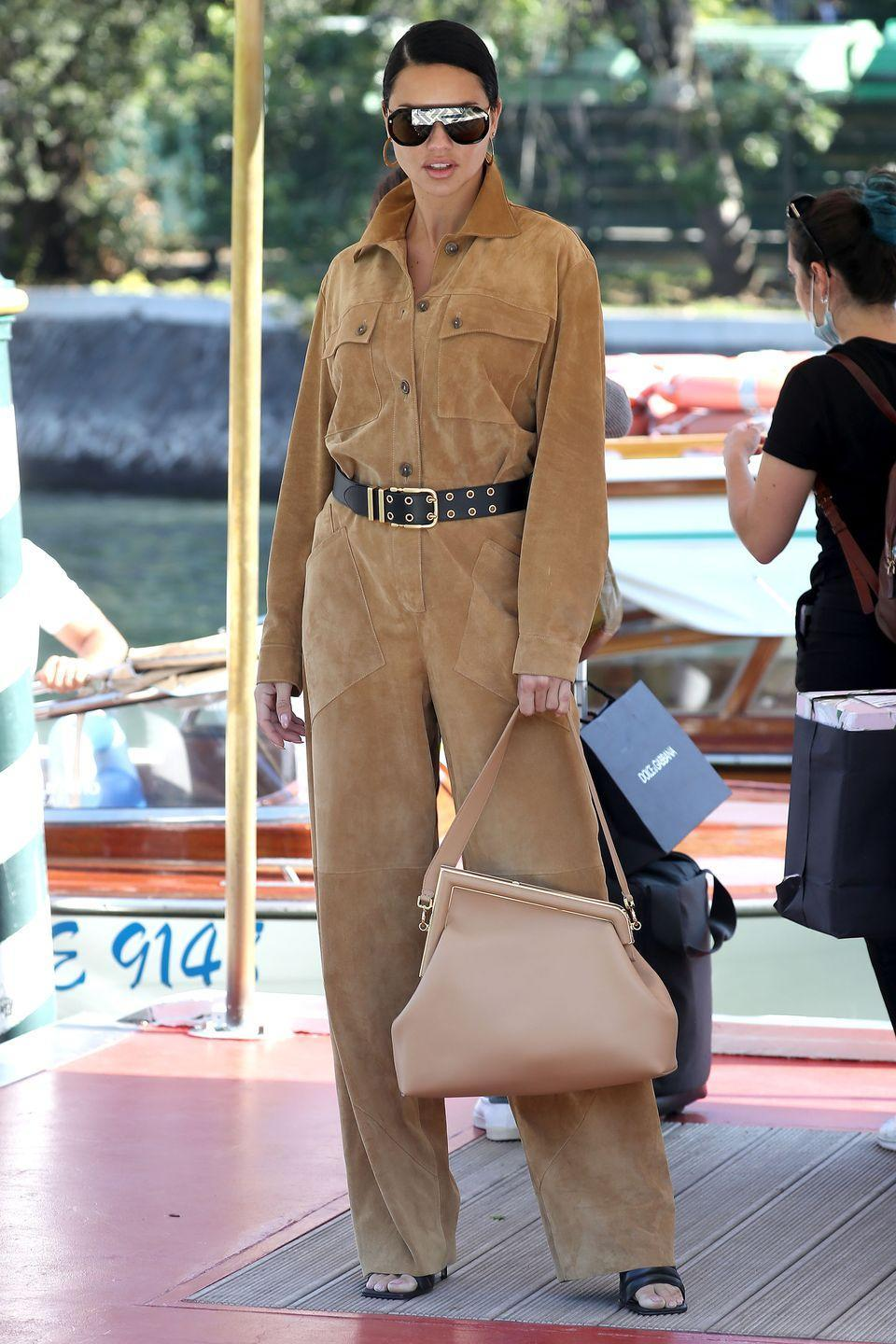 <p>Adriana Lima made a case for the suede jumpsuit as she arrived for the festival. </p>