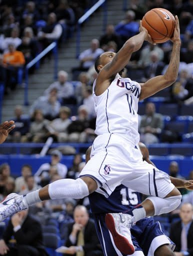 CORRECTS DATELINE TO HARTFORD - Connecticut's Ryan Boatright drives against New Hampshire during the first half of an NCAA college basketball game in Hartford, Conn., Thursday, Nov. 29, 2012. (AP Photo/Fred Beckham)