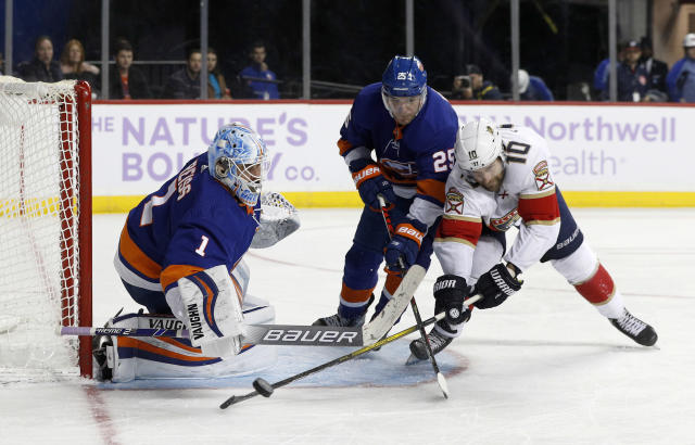 New York Islanders goaltender Thomas Greiss (1) and defenseman Devon Toews (25) stop a scoring chance against Florida Panthers right wing Brett Connolly (10) during the third period of an NHL hockey game, Saturday, Nov. 9, 2019, in New York. (AP Photo/Jim McIsaac)