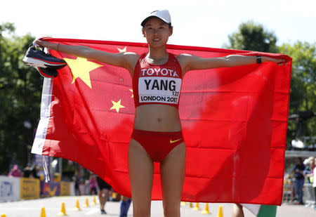 Athletics - World Athletics Championships – women's 20 km walk – London Stadium, London, Britain – August 13, 2017 – Jiayu Yang of China celebrates winning a gold medal. REUTERS/Matthew Childs
