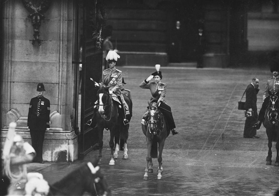 11th June 1953:  Queen Elizabeth II taking the salute at the trooping of the colour on her official birthday in London. She is wearing the uniform of the Grenadier Guards Colonel-in-Chief and is accompanied by Prince Philip, Duke of Edinburgh.  (Photo by J. A. Hampton/Topical Press Agency/Getty Images)