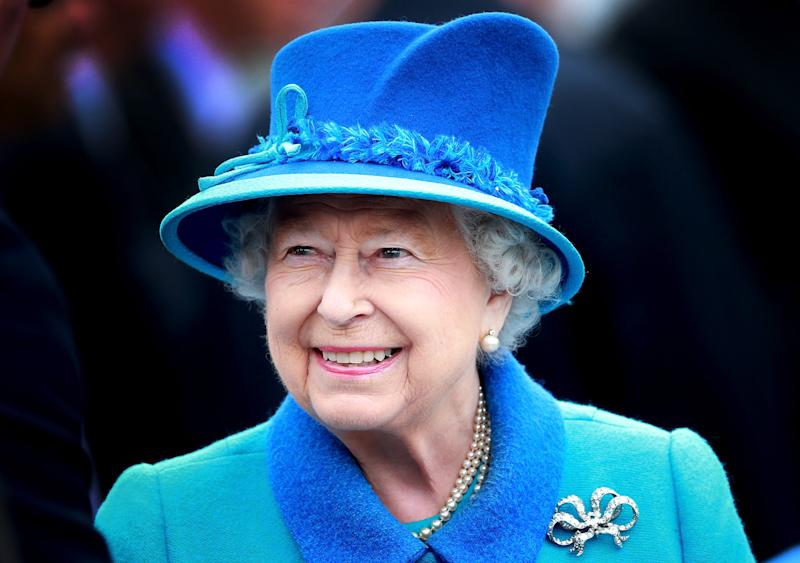 Queen Elizabeth in 2015 dressed in a blue suit and hat
